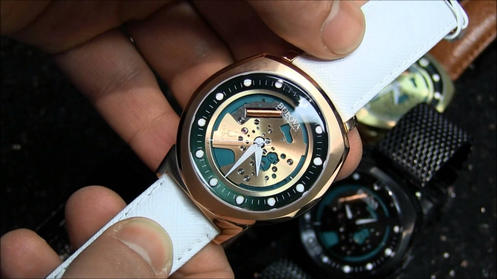 Bulova Accutron II Alpha UHF & Accutron II Lobster UHF: Luminous, round hour markers are set within an outer flange