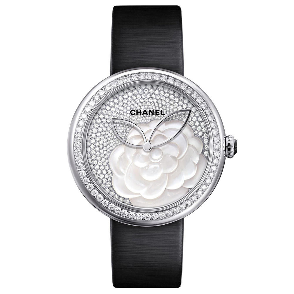 CHANEL WATCHES:the most famous and exclusive brands of only watch 2015 For this year's Only Watch auction, Chanel has collaborated with Maison Lesage to create a unique Mademoiselle Prive for Only Watch. Encased in 18-karat white gold, both the bezel and caseback are adorned with a combined total of 200 round brilliant cut diamonds, equaling roughly 2.49 carats. The dial is a wonderful reflection of Lesage's creativity, using elaborate motifs against a beige, hand-embroidered dial. Drawing inspiration from Mademoiselle Chanel, the meticulously crafted dial features a reinterpretation of her favorite flower, the camellia. Carefully designed with knotted and chain stitching, each flower is topped with a natural pearl. This unique timepiece is fitted with a matching white satin strap, with a diamond set 18-karat white gold ardillon buckle. All funds raised at the Only Watch 2015 charity auction will benefit research for Duchenne Muscular Dystrophy. TECHNICAL SPECIFICATIONS FUNCTIONS:Hours, Minutes CASE:Round White gold Diamond Set 37.50mm GLASS: Sapphire YEAR 2015 MOVEMENT: Self Winding/Automatic Manufactured:Swiss Made BUCKLE:Pin Buckle White gold WATER RESISTANCE: 3.00atm / 30.00m / 100.00ft Why is this watch unique ? For nearly a century, for all the major names in Haute Couture, Lesage has embroidered highly elaborate motifs requiring many hours of work and great virtuosity. The exquisite motif on this highly poetic dial is the fruit of a long tradition. Against a striking backdrop of fabric dial, natural pearls, knotted and chain stitching come together to form a motif of a rare poetry. Numerous technics of embroideries are needed to create this sumptuous dial : The petals' outline of the camellias gives the illusion that a chain frames the flowers : they are made with metallic threads embroidered with a Luneville hook. Straight points are embroidered with bright white silk threads to form the inner petals of this poetic model, giving depth to the dial. The dial is unique, revealing the embroiderer's freedom of movement throughout her patient creative work. Since the birth of the House, exceptional savoir-faire has always been at the heart of CHANEL creations. MADEMOISELLE PRIVE collection pays tribute to watchmaking arts and skills such as enamelling, engraving, setting and marquetry, but also to the artistic crafts of Couture. To enhance these exceptional timepieces, CHANEL has called on the services of Maison Lesage, the guardians of a rare and precious expertise of embroideries. Mademoiselle Chanel loved the delicate elegance and subtle milky colour of the camellia, making it her favourite flower. This symbolic flower is gracefully reinterpreted in this unique model. Fruit of an exquisite collaboration with Maison Lesage, the camellias are embroidered here with silk and metallic threads and natural pearls. This exceptional piece is hand-stitched in a highly delicate display of precision and refinement.